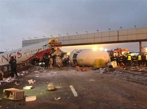 Jet rolls off Moscow runway, splits apart (Photo: Alexander Usoltsev / AP) MOSCOW — A Russian airliner split into pieces after it slid off the runway and crashed onto a highway outside Moscow on Saturday, killing at least four of the 12 crew on board and leaving smoking chunks of fuselage on the icy road. Read the complete story.
