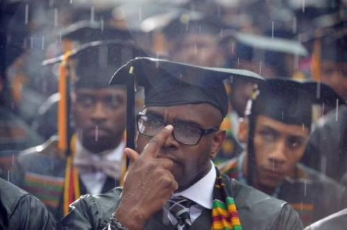 "thistr3reads:   ablacktv:   ""Kia Speaks    This picture of Morehouse graduates drenched in rain yesterday has surprisingly caused quite a stir. Many are saying it's indicative of Morehouse not having the money or common decency to implement a rain plan. If you see that when you look at this picture, I'm going to politely take the liberty to call you a cynic. To me this picture symbolizes the journey that so many black men endure everyday of their lives as they face countless obstacles yet continue to pursue success with unwavering determination. It is cynical to ignore the fortitude and thirst for knowledge in these men's eyes for an opportunity to knock/shade/read Morehouse. Rain can't stop the House, & life's obstacles won't stop these men.  FYI: Grads from major universities are soaked like this all the time with no controversy.""       Yep. I watched friends graduate in 2006 at UC Berkeley in torrential rain soooo…..   To me, this pictures says, ""We're gonna fucking walk, rain or shine.""  Doesn't matter if they're black men, native american women, asian people who don't identify with either of the two main genders, or you and me.  College is hard for everybody, and to go to graduation and be able to walk is an accomplishment no matter the weather."