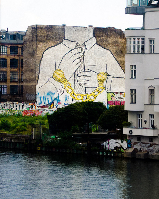 angelainyellow:Golden HandcuffsStreet Art by BLUBerlin