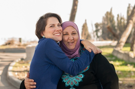 "An Israeli and Palestinian, Brought Together By Breast Cancer  ""We are not the ones at war,"" Ibtisam told me. ""It's our governments, not us."" Read more. [Image: Yitz Woolf]"