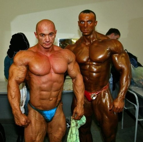 musclelover:  Alexey Sha bunya all tanned and ready for the stage. His biceps and pecs are massive in this image. Anyone know the other guy?