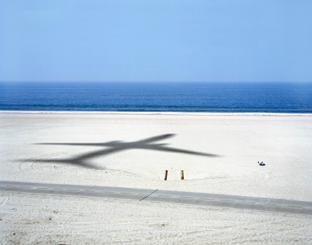 Dad napping on beach, and passing aircraft. Dockweiler State Beach, 2007. Photo from the Landscape series by Alex Fradkin, an American photographer.