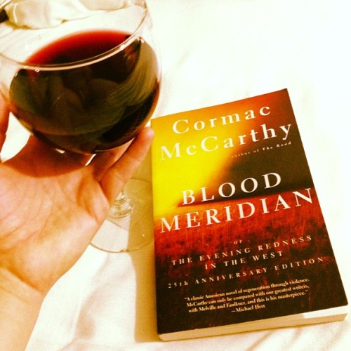 After work with a book for my last class and a glass of wine. #may #mayphotoaday #photoaday #photoadaychallenge #day15 #dayfifteen #red #read #seewhatididthere #redwine #wine #cormacmccarthy #bloodmeridian #theeveningrednessinthewest #soappropriate #yes #reading