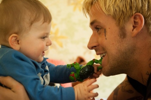 menwithchildren:  A new still out of The Place Beyond the Pines. Guys, I'm pretty sure this picture totally and completely makes up for the bleached hair. Really.  he's even good with babies! AAHHHH