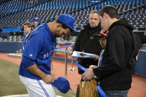 Jose Bautista signs autographs for some lucky fans before last night's Blue Jays vs. Indians game. #LoveThisTeam
