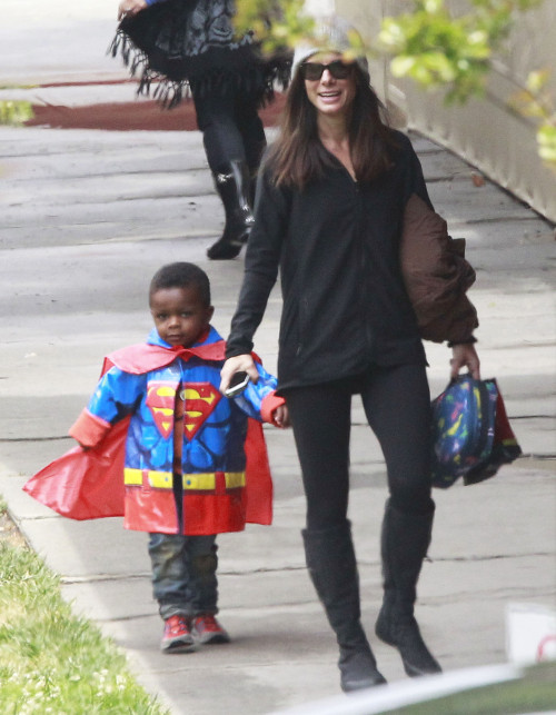melancholybeing:  Sandra Bullock was all smiles with her son Louis in Los Angeles, California on Monday (May 6). The adorable preschooler looked so cute in his Superman raincoat.
