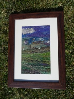 Felted landscape.   This landscape started as drum carded merino wool, with added silk fibres and banana fibres.   Before felting silk cocoons were added and other threads.   Wet felted and then embellished with freehand machine embroidery.   It can be seen at the VixCrafts Facebook page or www.etsy.com/shop/vixcrafts