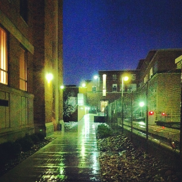 co-exist-ing:  Rainy days on campus. #wvu #morgantown #rain #lights  Nice image.