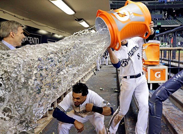Carlos Gomez ducks out of the way as teammate Ryan Braun tries to douse him with water following the Brewers 4-3 win over the Giants. Gomez went 3-for-4 with a run and RBI in the game. (Morry G