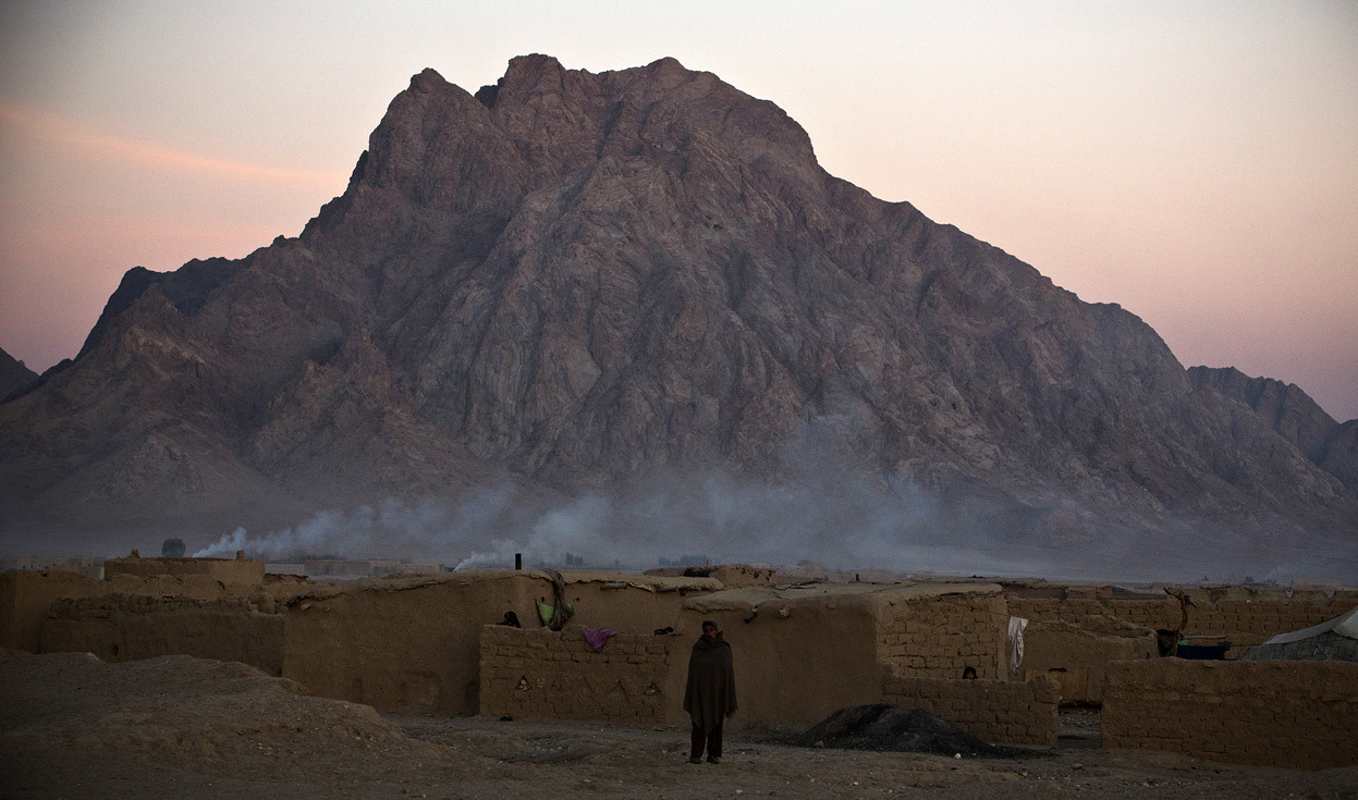 From Afghanistan: January 2013, one of 39 photos. Here, an Afghan man stands outside a compound near the town of Hutal in Maywand District, Kandahar Province, Afghanistan, January 20, 2013. (Reuters/Andrew Burton)