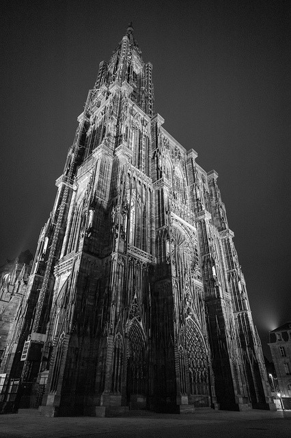 "Notre-Dame de Strasbourg, March 2013. Shame on me, I had never posted a photo of the gorgeous cathedral of Strasbourg (the most beautiful of french cathedrals imho, and I'm not that biased, being born and raised in Lyons, not Strasbourg). The hard part being, for that shot, to have a lens wide enough to frame and shoot that 142m (466 ft) one towered beast of a gothic beauty. The tallest in the world from 1647 to 1874. In this case, I used the Super Elmar 21mm which is really one fine piece of gear. Well built, rather small and ultra sharp wide open. Even if its max aperture of 3.4 won't allow the miracles its Summilux counterpart is capable of. But the two 21mm wide angles of the Leica roster don't play in the same league: the Super Elmar costs around 2300€, its bulky and super-expensive sibling costs a whopping +5000€. Furthermore, the marvels of the MM in high iso perfectly counterbalances the rather modest aperture of 3.4. I shot @ f3.4, iso 4000 (!) with a speed of 1/12 sec and it's rather sharp, with no grain, me thinks. Of course, you can always go for the Voigtlander 21mm f4. It's a great tiny lens for FILM cameras: it vignettes a lot, which is not a problem for me but bothers some, and, above all, it suffers from heavy color shifting when used on the M9. And that's, in my book, a real issue: I don't want to be obliged to ""Corner fix"" - a great plug-in able to fix those kind of problems -every shot.  But on the M Monochrom, is it a viable option? Yes, if you can live with the vignetting and a lot less sharpness. Anyway, I'll soon kiss my sample goodbye, as I don't use that focal length enough to keep two 21mm."