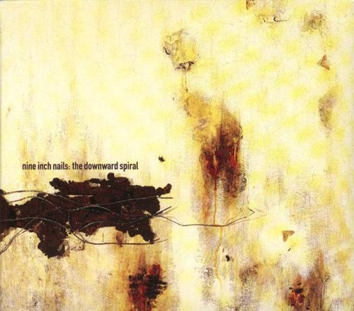 mescalineeyes:  Nine Inch Nails - The Downward Spiral (1994) devils speak of the ways in which she'll manifest  angels bleed from the tainted touch of my caress  need to contaminate to alleviate this loneliness  i now know the depths i reach are limitless