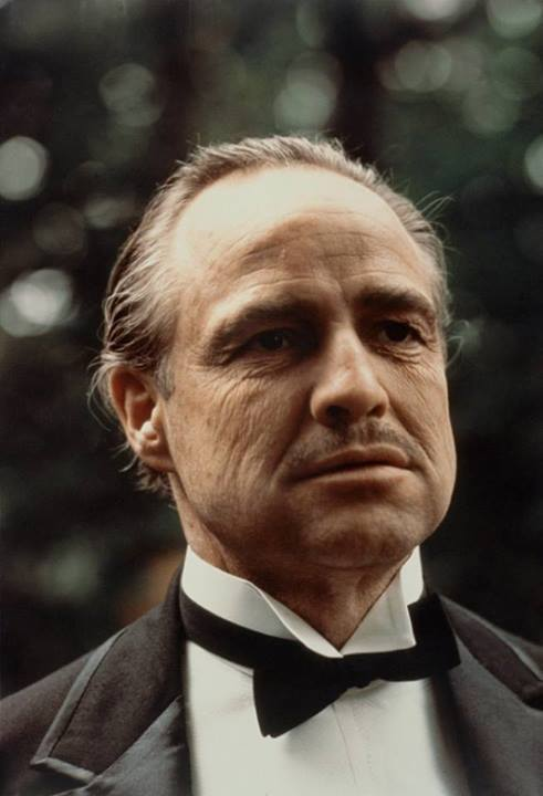Marlon Brando in a bow tie as Godfather
