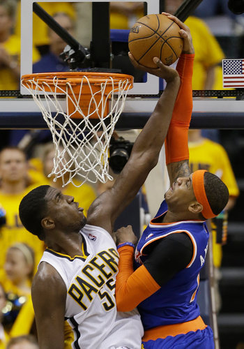 inothernews:  Says it all. (Photo of Indiana's Roy Hibbert blocking an attempted dunk by New York's Carmelo Anthony during the final moments of a 106-99 Knicks series-ending loss by Darron Cummings / AP via the New York Times)