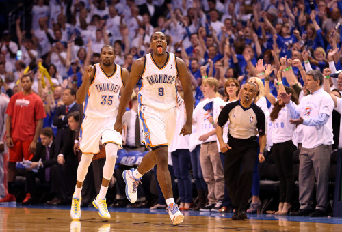 nba:  Serge Ibaka #9 of the Oklahoma City Thunder celebrates ahead of Kevin Durant #35 after Ibaka scored against the Houston Rockets during fourth quarter of Game Two of the Western Conference Quarterfinals of the 2013 NBA Playoffs at Chesapeake Energy Arena on April 24, 2013 in Oklahoma City, Oklahoma. The Thunder defeated the Rockets 105-102.  (Photo by Christian Petersen/Getty Images)