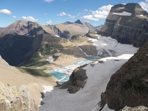 rhamphotheca:  Grinnell Glacier is in the heart of Glacier National Park in the U.S. state of Montana. The glacier is named for George Bird Grinnell, an early American conservationist and explorer, who was also a strong advocate of ensuring the creation of Glacier National Park. The glacier is in the Lewis Range and rests on the north flank of Mount Gould at an altitude averaging 7,000 feet (2,100 m), in the Many Glacier region of the park… (read more: http://en.wikipedia.org/wiki/Grinnell_Glacier)               (photo: Mountain_Walrus | Wiki)