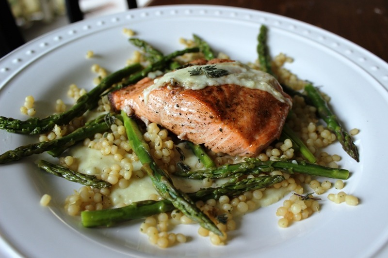 Steelhead on a potato/herb/garlic/cream reduction with roasted pearl couscous and asparagus.