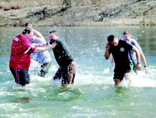 "Freezin' for a Reason: Cherokee Marshals Take 'Polar Plunge', Raise More Than $3,000 for Special Olympics Several gasps and a lot of shivering by Cherokee Nation marshals and Sequoyah High School staff were evident February 23 as both groups dove into a frigid Illinois River. The groups took part in the statewide ""Polar Plunge"" fundraising event to raise money to send athletes to the Special Olympics. Cherokee Nation marshals and a few Sequoyah faculty and students, together raised more than $3,000 for the cause."