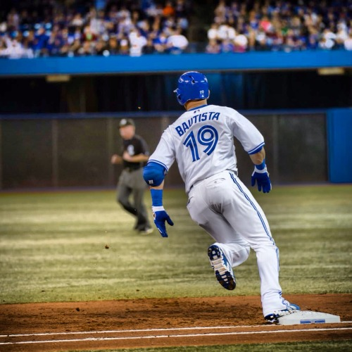 Jose Bautista rounds first base on Honda Opening Night.  #LoveThisTeam
