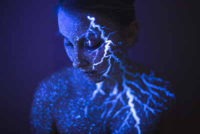 We are All made of Stars  © Daria Koroshavina #nature#art#blue#space#sky#dark#black#glow#storm#aesthetic#colorful#stars#ultraviolet#light#uv#thunder#vibrant#universe#lightning#ultraviolet light#uv light #glow in the dark #black light #black light art #photography#thunderstorm#bodypaint#body paint#daria koroshavina #photographers on tumblr