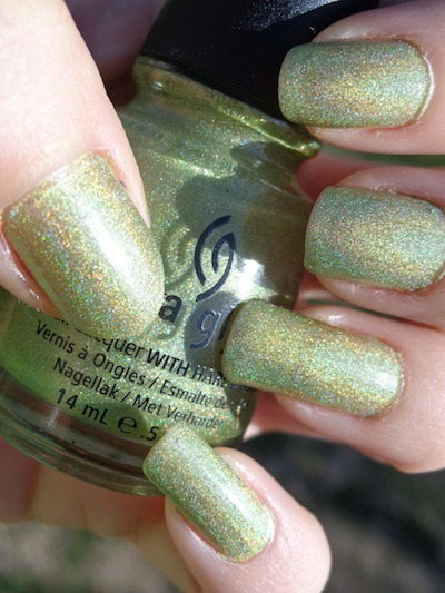 "tikibarbie:  China Glaze ""Laser Lime"" - a scattered holographic lime green with a linear effect.  This is 2 coats.  From the Spring 2011 Tronica collection."