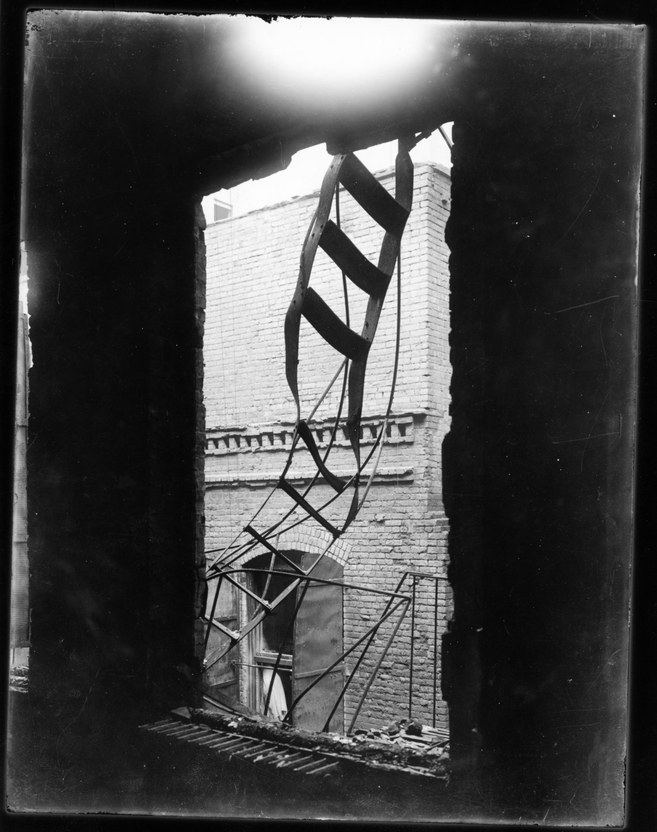 todaysdocument:   Photograph of a Broken Fire Escape after the Triangle Shirtwaist Factory Fire, 03/25/1911  One of the deadliest industrial disasters in United States history, the Triangle Shirtwaist Factory fire in New York City left 146 workers dead in 18 minutes on March 25, 1911.   Locked doors kept the workers from escaping; there was not enough water to put out the flames, and firemen's ladders were too short to reach the upper stories. Many of the young women and men working there leapt out the windows and fell to their deaths onto the sidewalk outside. Others were crushed in the elevator shaft or when the fire escape collapsed. The fire led to sweeping reforms in labor laws and safety standards, providing a boost to labor unions, and was a pivotal event in the career of future labor secretary Frances Perkins. (Last year's post has additional photos of the fire and the victims, a few may be considered graphic.) via Prologue: A Factory Fire and Frances Perkins