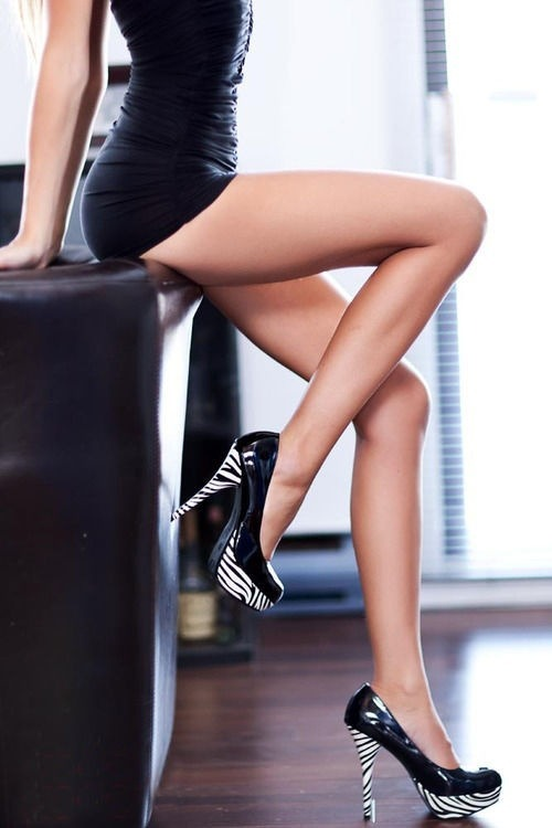 hotchicksallday:  Tiny black dress, legs, and heels