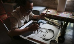 Chinese farmer Yang Chuanye makes a charcoal portrait of Chairman Mao Zedong, in Jishan county, Shanxi province. Yang, 62, started making charcoal paintings when he was 20. Apart from painting portraits of former and current Chinese leaders, Yang also paints portraits of deceased people from his county. (via Guardian, Photograph: REUTERS)