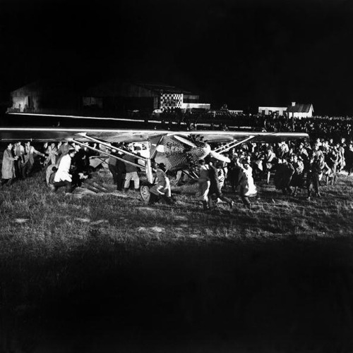 thats-the-way-it-was:  May 21, 1927: Charles Lindbergh lands in Paris Pilot Charles A. Lindbergh lands at Le Bourget Field in Paris, successfully completing the first solo, nonstop transatlantic flight and the first ever nonstop flight between New York to Paris. His single-engine monoplane, The Spirit of St. Louis, had lifted off from Roosevelt Field in New York 33 1/2 hours before.  (history.com) Photo: The plane SPIRIT OF SAINT LOUIS, piloted by the American aviator Charles Lindbergh lands at the airport of Le Bourget. (Keystone-France/Gamma-Keystone)