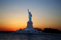 senerii:  Statue of Liberty Sunset by robertocordon on Flickr.