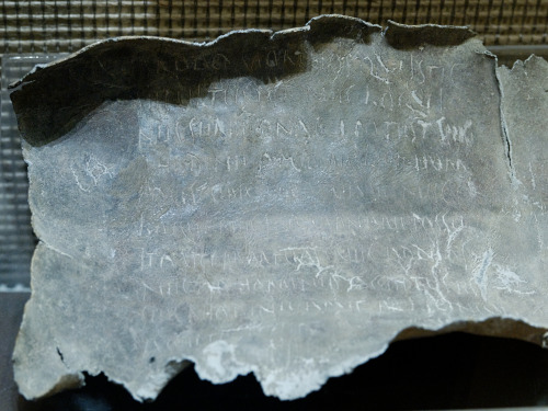 "Lead Curse Tablet -Roman ~1st century BC ""Just as the dead man who is buried here can neither speak nor talk, so may Rhodine die as far as Marcus Licinius Faustus is concerned and not be able to speak nor talk. As the dead man is received neither by gods nor humans, so may Rhodine be received by Marcus Licinius and have as much strength as the dead man who is buried here. Dis Pater, I entrust Rhodine to you, that she be always hateful to Marcus Licinius Faustus. Also Marcus Hedius Amphio. Also Gaius Popillius Apollonius. Also Vennonia Hermiona. Also Sergia Glycinna"