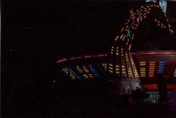 lastly, a dusty photograph of a gravity ride thing at the state fair