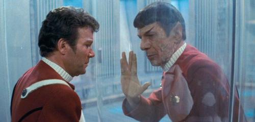 Spock: Don't grieve, Admiral. It is logical. The needs of the many outweigh… Kirk: …the needs of the few. Spock: Or the one. I never took the Kobayashi Maru test, until now. What do you think of my solution? [he kneels] I have been, and always shall be, your friend. [he places his hand on the chamber glass] Live long, and prosper.[Kirk places his hand against the glass as Spock slumps and dies] Kirk: No…