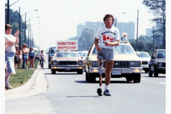 "abluegirl:  Terry Fox goes to Hollywood  It took 33 years, but Terry Fox has made it all the way to Hollywood. On the anniversary of the day Fox started his Marathon of Hope by dipping his prosthetic leg in the Atlantic Ocean, his family and a California production company announced they're hoping to bring his life story to the big screen. Terry Fox: the Feature Film will go beyond the movie and TV efforts of the past and bring star power to his cause, with 100 percent of the film's profits going to cancer research. ""We really need a real hero today, we don't have them,"" said producer Kelly Slattery. ""When Americans think of heroes, they think about how much money an athlete has and how powerful they are … Terry Fox died with a nickel in his pocket and raised $22 million and gave his life. That's a real hero. We need to get back to what charity really is."" Slattery grew up in Toronto surrounded by images of Terry Fox. ""We didn't have crucifixes. We had Terry Fox on our walls. He's definitely who we looked up to,"" she said. Her father, an Adidas executive, framed the letter he received from Terry asking for a shoe sponsorship. He spoke often of the young hero to his kids and collected all sorts of memorabilia — images that stayed with Slattery her whole life. Generations of Canadians have been moved by the story of a quiet young man from British Columbia who hop-stepped halfway across the country on one leg to raise money for the disease that cut his run and his life short in 1981 at age 22. Slattery, now a Los Angeles-based movie producer, wants to take that story global, bringing it to a new generation and reviving Fox's dream of finding a cure. Her company, Therapy Content, won accolades at this year's Sundance Film Festival for Dave Grohl's documentary Sound City, and is looking to build on that success with a non-profit feature film, budgeted at about $10 million. ""Our goal is to have this be the biggest philanthropic campaign of all time,"" said the producer, who hopes to make $100 million for the Terry Fox Research Institute. ""It sounds outlandish, but I'm with Terry Fox. I have big dreams."" The film will do more than remind people of his story. Envisioning an actor such as Anton Yelchin (Like Crazy) playing the lead, Slattery wants to plunge into the little-known nitty-gritty details, like the days he ran through the snow and the nights he slept in a van with no heat. She hopes to inspire millions of young people to start up Terry Fox runs across America. ""There is a power to Terry Fox and what he did: that subconscious message of greatness,"" said Slattery. Darrell Fox, who accompanied his brother for every step of the Marathon of Hope, is a big supporter of the project. ""I'm reminded of 1980, when I was hanging out with Terry in a stinky Ford van,"" he said. After an event outside of Toronto, Terry was approached by a reporter who asked him what he hoped would come of his run. ""And with two words he said: 'more money,'"" remembered Darrell. ""That's a driver for us. We're on a journey; we're trying to finish the Marathon of Hope. We've certainly come a long way in eliminating the suffering that cancer causes, but it is a journey and there's still more to accomplish.""  Terry Fox was a Real Canadian Hero. I'm so glad to hear that a film of his life is in the works."