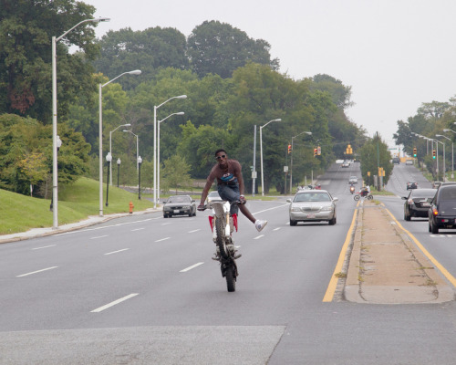 Popping Wheelies In Charm City Baltimore's dirt-bike street riders.