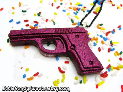 (via Dark Pink Glitter Gun Pistol Necklace by littlecandysweets on Etsy)