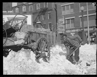 Colored man digging out horse and cart by Boston Public Library on Flickr.