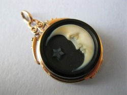 blackpaint20:  A Victorian gold-set cameo pendant depicting the man in the moon.