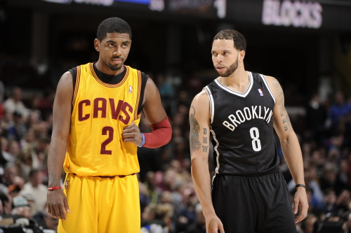 nba:  Kyrie Irving of the Cleveland Cavaliers shares a word with Deron Williams of the Brooklyn Nets during a break in the action at The Quicken Loans Arena on April 3, 2013 in Cleveland, Ohio. (Photo by David Liam Kyle/NBAE via Getty Images)