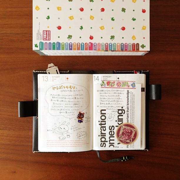 "Tiny Review: Hobonichi Techo 2013 It might seem odd for Tiny Cartridge to review a daily planner, but I'm always curious about anything Mother/Earthbound creator Shigesato Itoi is involved in, whether it's his copywriting work, his appearances on Iron Chef as a judge, or even his free DSiWare app for tracking your health. Plus, when I shared the news last month that Itoi's company Hobonichi released its popular Japanese planner in English for the first time this year, many of you showed interest in importing a copy. Hobonichi was kind enough to send a Techo (planner) over for us to review, so now you get to hear why you should (or shouldn't) buy the planner.  Four things that are fab: 1. The creativity it encourages - The Techo can be used as a traditional organizer to schedule your life and plot out appointments, but the design of its daily pages, each outlined with a charcoal gray grid, allow for and encourage much more. You can use it as a diary, comic journal, scrapbook, sketchbook, school notebook, budget tracker, etc. Fill it with illustrations of cats or Animal Crossing's K.K. Slider if that's what you're into; this isn't a planner you have to take seriously.  Having no artistic ability, I'm using mine as a chronicle for a mishmash of things, recording my work-out progress, new food I've tried with short reviews, moments/jokes I enjoyed with my wife, tweets from @therealjuicyj I want to remember, whatever I watched or listened to that day, etc. I'm trying to live that examined life. 2. The quotes - Plenty of calendars and planners are filled with inspiring daily words, but being from Itoi and his company, the Techo offers eccentric quotes taken from his interviews and articles posted on Hobo Nikkan Itoi Shinbun, much of them never published in English. Take these words from Itoi printed on the the very first days of the year for instance:  The idea of 'just another day' is really quite curious.You could say it's just like every other day,or you could say there's no other day like it.Someone is born; some people break up.Those are some of the things that take place on 'just another day.'  And because Itoi's worked closely with them over the years, you'll find quotes from Nintendo's Satoru Iwata and Shigeru Miyamoto in there, too. It's a treat to turn the pages every other day, and read the next quote. 3. The accessories - Something about the Techo makes you want to go out and buy accessories to enhance your experience with it, and Hobonichi is more than happy to sell you a wide range of ""tools and toys"" through its site: stickers, stencils, pens (I bought a multi-color Muji pen to keep clipped to my planner case), tiny scissors, mini post-its, small Polaroid cameras that print photo stickers, and other items to decorate your pages with. Hobonichi provided me with one of its classy leather cases, which are way pricy at $158 apiece but definitely feel/look expensive. People might mistake you for a professional who's on top of things and making bank when you pull one of these out at work, even if your Techo is nothing more than a collection of drawings you've made of butts.  Seeing the dozens of other cases Hobonichi sells, I want to pick up another one with more pockets, as they can double as wallets or pouches that hold things you want handy. For those seeking a personal touch, there are clear jackets that you can slide your own designs into — or you can create a cover like Birdie's Mother-embroidered case pictured above. 4. The community - There's already a growing group of Techo fans in the West, partly due to the Mother fans who've picked one up, and also due to the efforts of Lindsay Nelson, who helped localize the planner. Lindsay has not only created a site that shows you how to buy and get the most out of your planner; she's created a Tumblr where people can post Techo photos to show their love. Marveling over the creative ways others are using their Techos has given me plenty of ideas for how to enjoy my planner. It's like the physical planner equivalent to downloading updates that introduce new features to a journaling app, or seeing others post hacks/mods for their Techos. Three things that are butt: 1. We live in a digital age - Tumblr, Facebook, Google Calendar/iCal, or apps like Evernote can do almost everything the Techo can as far as traditional planner tasks go, short of delivering you quotes from Itoi. For many, the physical planner just lacks the power features digital solutions provide: sharing with friends and contacts, commenting and reblogging, tagging and searching, easy importing and exporting, etc. And copying and pasting is so much more convenient when it's a couple of keystrokes, not a minute spent cutting out and gluing whatever you want to save.  There are still special joys you can only get with a physical journal like the Techo, however, like searching for the perfect pen to pair with your planner, or getting to mark in the margins that a sports team you follow won, or using a butt-based scoring system to rate your day, or affixing colorful cat stickers next to your appointments, or writing out the name of your lover or crush over and over during your daydreams, or making quick sketches of your meals, or slowly building a row of books on your shelf to create a multi-volume chronicle of your life (it helps that the simple jackets  and their spines look so attractive). 2. It's already mid-February - You might feel wasteful, buying a planner that spans December 2012 - December 2013. Or you can do what I did, and pick something you've been meaning to record, and fill the blank pages for those months you missed — recipes, the first chapters of that book you've been meaning to start writing, lyrics to Hall and Oates songs for quick reference, portraits of people in your life, unsent love letters to Tiny and/or our Lizard, etc. Or you could use those blank pages to stash footnotes from your daily entries. 3. It's more expensive than most planners - A Techo alone, without a cover, will cost you $29 before you even pay shipping and handling from Japan. You could get a discounted 3DS game for that amount!  Score:  I'm actually using my Techo - I couldn't tell you how many times I've purchased planners or received them from others, starting from my early teen years.  Without fail, I abandoned them within weeks, if not days. I've found the Techo so much fun to use, though, thanks to the community around it and how personalized mine feels. I expect to fill this planner's pages until the end of the year, and pick up a new one for 2014. I know some people who are interested in buying one are waiting for the 2014 edition, but I don't see the point of having a couple extra months' worth of pages, versus having something now that can help you organize your days/thoughts, and examine your life. Why put that off?  If you decide to buy a Techo, make sure to read Lindsay's instructions and bookmark this useful page. BUY Mother 3/Earthbound, Hobonichi Techo 2013IMAGES VIA Mochigram"