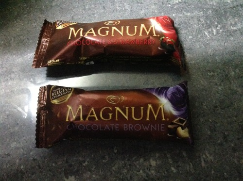 New Magnum Selecta's much-hyped, overpriced ice cream bar has two new flavors.  Presenting, the Magnum Chocolate & Strawberry and the Magnum Chocolate Brownie. Magnum Chocolate & Strawberry: vanilla ice cream with strawberry ripple and a Belgian-chocolate coating.  This one is delicious.  The ice cream is smooth and velvety, its flavors, well balanced.  The strawberry tastes authentic, not cough-syrupy.  And we usually complain about the Belgian chocolate shell being saccharine but for this variant, its flavor works well with the strawberry.  Maybe the fruity tartness tempers the sweetness. Magnum Chocolate Brownie: brownie ice cream covered with Belgian chocolate and chopped cashew.  The ice cream is good.  Its flavors are mellow, subtle.  Too bad these tastes are being overpowered by the milk chocolate coating (this time the Belgian chocolate flavor doesn't work well with the ice cream).  And since Magnum is already being marketed as something luxurious, why use cashew?  Walnuts please! Try these new Magnum flavors and judge for yourself.   Warning: they're still overpriced.