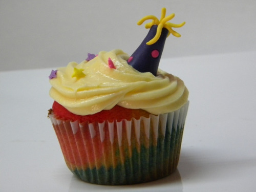 awkwardcupcake:  party hat rainbow cupcake by Bocaditos y Colores (Erika) on Flickr.