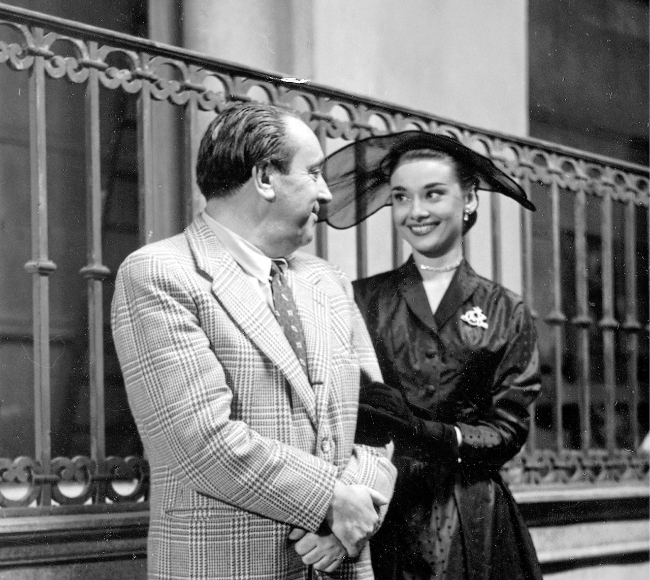 Audrey Hepburn and Michał Waszyński on the set of Roman Holiday in Rome, Italy, 1952.