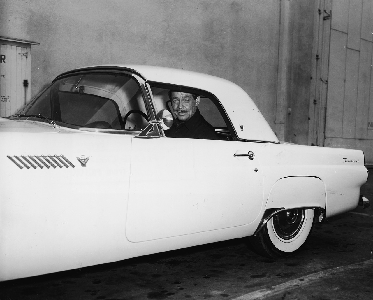 "Stars & Cars: Clark Gable Can you get any more American than a good ol' fashioned Ford Thunderbird? Launched in the mid-'50s, the ""T-Bird"" would eventually create the market for what they called a  ""personal luxury car."" Here's the suave Clark Gable increasing his swagger points with this 1955 model. Check out a few 1955 models available on eBay, one with a bid starting at $10,000.  (Photo: Courtesy of Getty. Text by Jauretsi)"