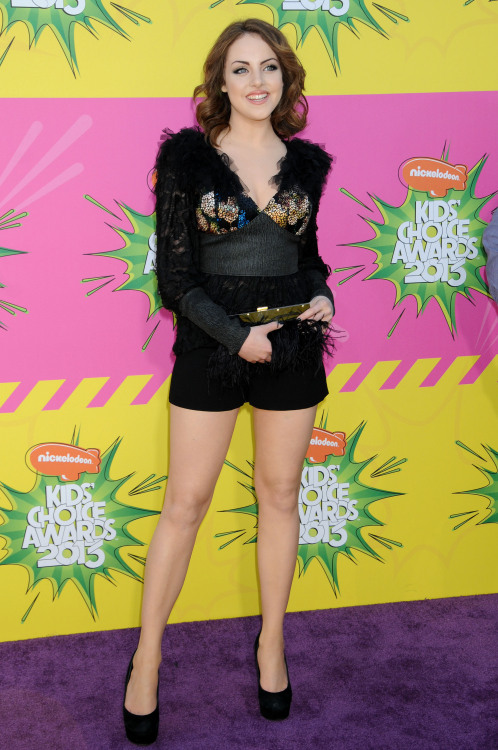 Elizabeth Gillies showing her perfect legs in black shorts and…