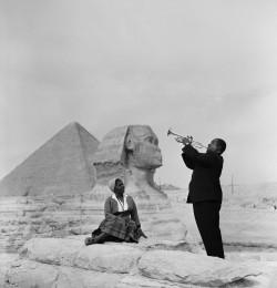 black-culture:  Louis Armstrong plays for his wife, Lucille, in front of the Sphinx and Great pyramids in Giza, Egypt.