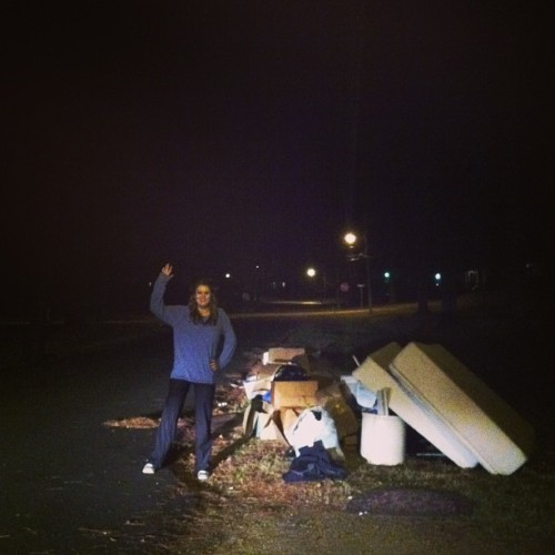 Nell waving in front of a pile of trash outside a foreclosed home!  #nellwave