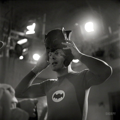 "megatrip:  Adam West on the set of the TV show ""Batman"" in 1966. From a series of photos taken by Richard Hewett for Look magazine. View full size."