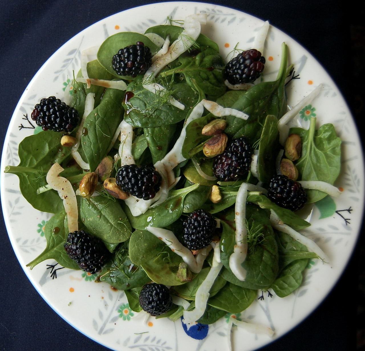 Spinach Blackberry Pistachio Salad:  Tender baby spinach is tossed with sweet blackberries and balanced by nutty pistachios. Fresh fennel bulb adds a slight licorice aroma and balsamic vinegar brings its own tang to this satisfying salad. This recipe comes to us from Elizabeth of Sophisticated Pie.