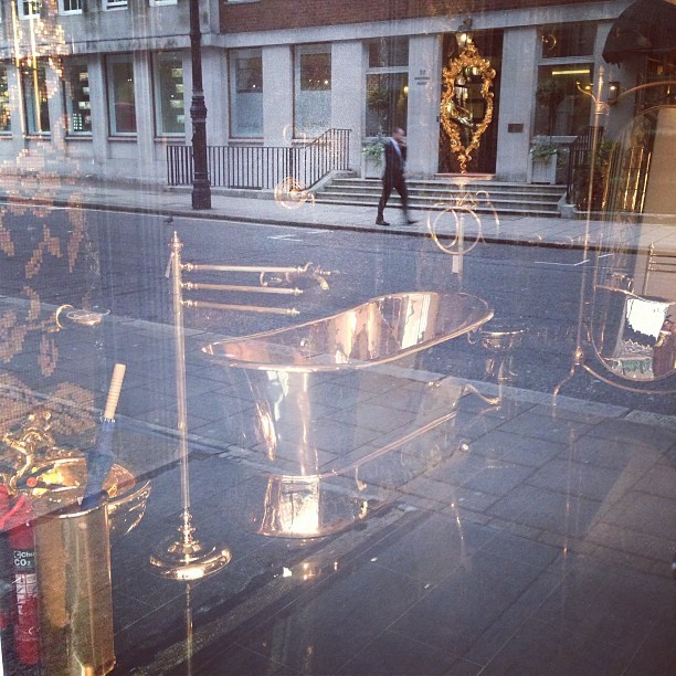luciekerley:  You know your in Mayfair when you see a gold roll-top bath!  Yup.